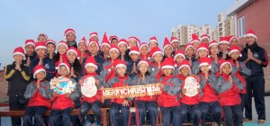 Children wishing Merry Chrismas